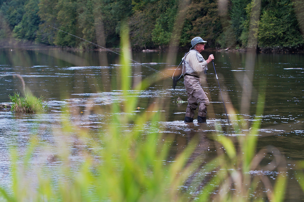 Lawrence Greasley, flyfisher from the UK, wading in the San River. Myczkowce, Poland.
