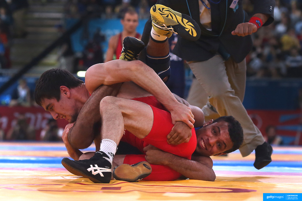 Vladimer Khinchegashvil, Georgia, and Ibrahim Farag Abdelhakim Mohamed, Egypt, in a tangle during the Men's Freestyle 55kg Wrestling tournament during the London 2012 Olympic games. London, UK. 9th August 2012. Photo Tim Clayton