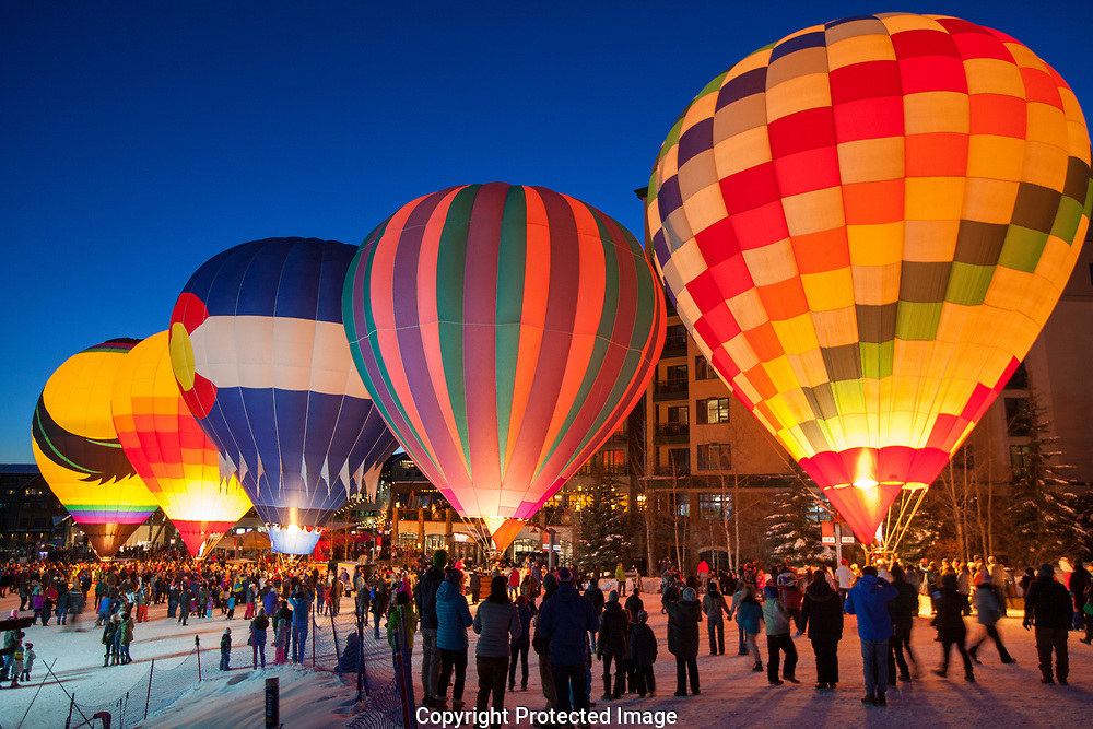 Hot Air Balloons are tethered and lit during the annual Balloon Glow at the base of the ski area at Steamboat Resort.