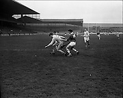 15/02/1970<br /> 02/15/1970<br /> 15 February 1970<br /> National Hurling League: Cork v Dublin at Croke Park, Dublin. <br /> W. Walsh (Cork) loses a fine pass to the Dublin full-back, B. Cooney, within easy scoring distance of the Dublin goal.