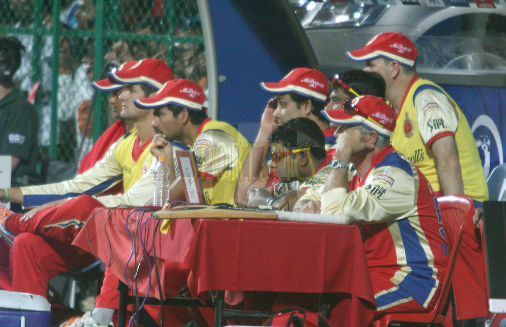 RCB players seen watching the actions from the players dugout during match 8 of the the Indian Premier League ( IPL ) Season 4 between the Royal Challengers Bangalore and the Mumbai Indians held at the Chinnaswamy Stadium, Bangalore, Karnataka, India on the 12th April 2011..Photo by Vino John/BCCI/SPORTZPICS