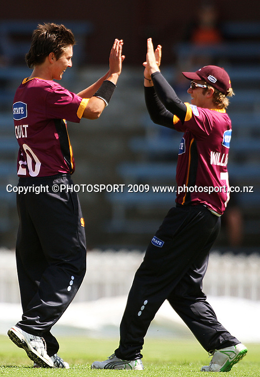 Kane Williamson (right) congratulates Trent Boult for bowling Wellington captain Matthew Bell for 11.<br /> State Shield cricket - Wellington Firebirds v Northern Knights at Allied Prime Basin Reserve, Wellington. Saturday, 17 January 2009. Photo: Dave Lintott/PHOTOSPORT