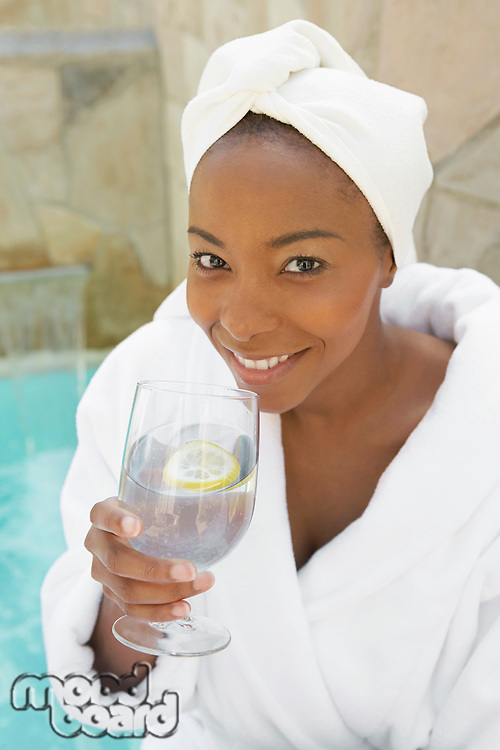 Woman with a Glass of Water at a Spa