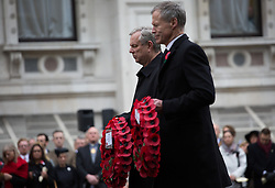 The Anzac Day tradition -WW1 memorial. New Zealand High Commissioner to the UK Sir Alexander Lockwood Smith, right, and Australian High Commissioner to the UK Mike Rann hold wreaths in a service of remembrance at the Cenotaph on Whitehall, London, United Kingdom. Friday, 25th April 2014. Picture by Daniel Leal-Olivas / i-Images