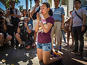19 AUGUST 2015 - BANGKOK, THAILAND: A woman who lost family members in the terror bombing at Erawan Shrine prays during a memorial service at the shrine's reopening. Erawan Shrine in Bangkok reopened Wednesday morning after more than 20 people were killed and more than 100 injured in a bombing at the shrine Monday, August 17, 2015. The shrine is a popular tourist attraction in the center of Bangkok's high end shopping district and is an important religious site for Thais. No one has claimed responsibility for the bombing.      PHOTO BY JACK KURTZ