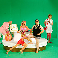 Picture shows : Tiziano Bracci as Mustafa (centre) with bunny girls. Paul Carey Jones as Haly (pink jacket). Julia Riley as Zulma (with red bag) and Mary O'Sullivan as Elvira (far right)..Picture  ©  Drew Farrell Tel : 07721 -735041..A new Scottish Opera production of  Rossini's 'The Italian Girl in Algiers' opens at The Theatre Royal Glasgow on Wednesday 21st October 2009..(Soap) opera as you've never seen it before..Tonight on Algiers.....Colin McColl's cheeky take on Rossini's comic opera is a riot of bunny girls, beach balls, and small screen heroes with big screen egos. Set in a TV studio during the filming of popular Latino soap, Algiers, the show pits Rossini's typically playful and lyrical music against the shoreline shenanigans of cast and crew. You'd think the scandal would be confined to the outrageous storylines, but there's as much action off set as there is on.... .Italian bass Tiziano Bracci makes his UK debut in the role of Mustafa. Scottish mezzo-soprano Karen Cargill, who the Guardian called a 'bright star' for her performance as Rosina in Scottish Opera's 2007 production of The Barber of Seville, sings Isabella. .Cast .Mustafa...Tiziano Bracci.Isabella..Karen Cargill.Lindoro...Thomas Walker.Elvira...Mary O'Sullivan.Zulma...Julia Riley.Haly...Paul Carey Jones.Taddeo...Adrian Powter. .Conductors.Wyn Davies.Derek Clarke (Nov 14). .Director by Colin McColl.Set and Lighting Designer by Tony Rabbit.Costume Designer by Nic Smillie..New co-production with New Zealand Opera.Production supported by.The Scottish Opera Syndicate.Sung in Italian with English supertitles..Performances.Theatre Royal, Glasgow - October 21, 25,29,31..Eden Court, Inverness - November 7. .His Majesty's Theatre, Aberdeen  - November 14..Festival Theatre,Edinburgh - November 21, 25, 27 ...Note to Editors:  This image is free to be used editorially in the promotion of Scottish Opera. Without prejudice ALL other licences without prior consent will be deemed a breach of copyright under t
