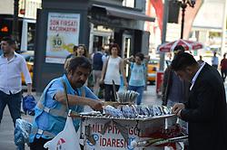 June 25, 2017 - Ankara, Turkey - A man buys a lottery ticket on the street on the first day of Eid al-Fitr in Ankara, Turkey on June 25, 2017. (Credit Image: © Altan Gocher/NurPhoto via ZUMA Press)