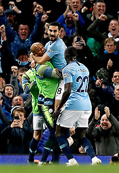 Manchester City's Ilkay Gundogan (top) celebrates scoring his side's third goal of the game with team-mates during the Premier League match at the Etihad Stadium, Manchester.