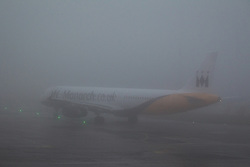 © Licensed to London News Pictures . 09/01/2013 . Manchester , UK . A plane on the ground in thick fog . Thick fog is causing flight delays and cancellations in the North of England today (9th January 2013) . Photo credit : Joel Goodman/LNP