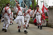 Morris Men dance on St George's Day in the gardens of St Botolph's without Bishopsgate church in the capital's financial district (aka The Square Mile), on 23rd April, City of London, England.
