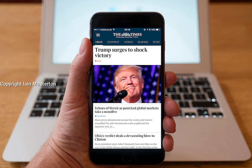 Detail of iPhone smart phone showing online mobile  newspaper front-page headline from The Times  following Donald Trump's victory in 2016 US Presidential Election