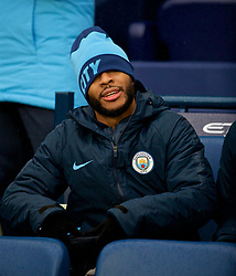 MANCHESTER, ENGLAND - Saturday, December 15, 2018: Manchester City's substitute Raheem Sterling puts on a hat to keep warm before the FA Premier League match between Manchester City FC and Everton FC at the Etihad Stadium, the 232nd Merseyside Derby. (Pic by David Rawcliffe/Propaganda)