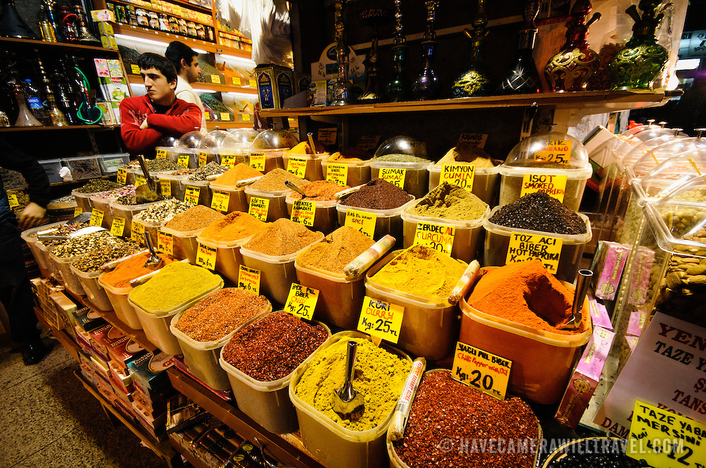 A shopkeeper waits for customers next to his display of spices available for sale at the famous Spice Bazaar (also known as the Egyption Bazaar) in Istanbul, Turkey.