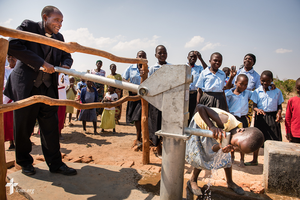 The Rev. Humphrey Nyirenda, central diocese pastor of the Confessional Lutheran Church–Malawi Synod, pumps water from a new LCMS funded well on Saturday, Sept. 26, in Embangweni, Malawi. LCMS Communications/Erik M. Lunsford