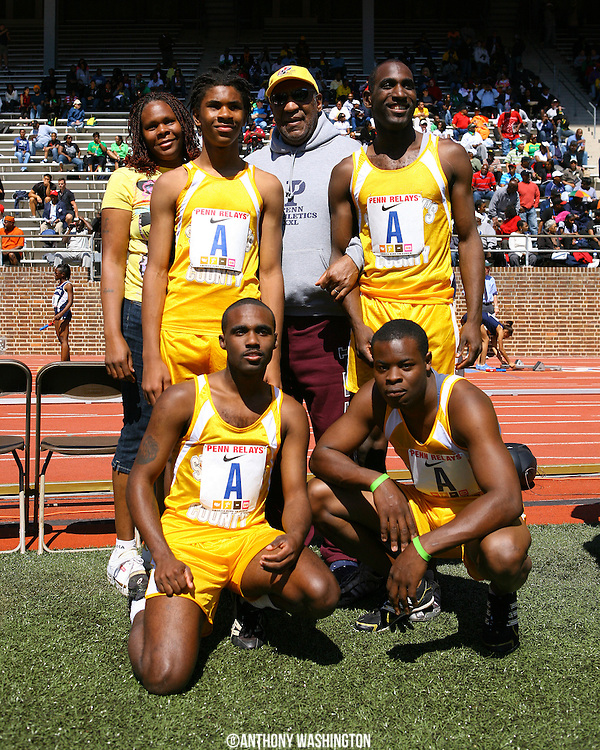 Mrs. Smith, Thomas Smith, Larry Mills, Avery Long and Terrell Nowlin pose for a picture with Bill Cosby after finishing first with a time of 47.52 in the Special Olympics 4x100 at the Penn Relays athletic meet on Friday, April 23, 2010 in Philadelphia, PA.
