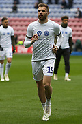 Leeds United midfielder Stuart Dallas (15) warming up during the EFL Sky Bet Championship match between Wigan Athletic and Leeds United at the DW Stadium, Wigan, England on 4 November 2018.