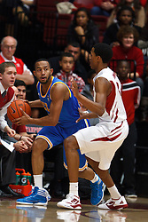 Dec 29, 2011; Stanford CA, USA;  UCLA Bruins guard Jerime Anderson (5) is defended by Stanford Cardinal guard/forward Anthony Brown (3) during the first half at Maples Pavilion.  Mandatory Credit: Jason O. Watson-US PRESSWIRE