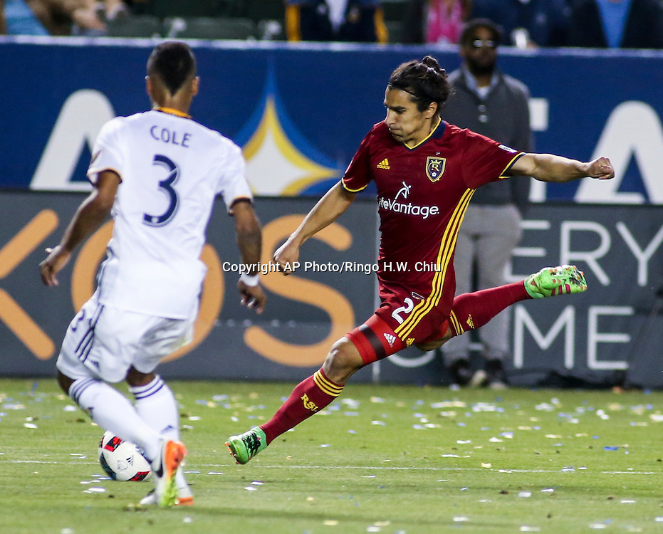 Real Salt Lake defender Tony Beltran, right, shoots against Los Angeles Galaxy defender Ashley Cole in the second half of an MLS soccer game in Carson, Calif., Saturday, April 23, 2016. The Galaxy won 5-2. (AP Photo/Ringo H.W. Chiu)