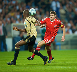 MARSEILLE, FRANCE - Tuesday, September 16, 2008: Liverpool's captain Steven Gerrard MBE and Olympique de Marseille's Ronald Zubar during the opening UEFA Champions League Group D match at the Stade Velodrome. (Photo by David Rawcliffe/Propaganda)