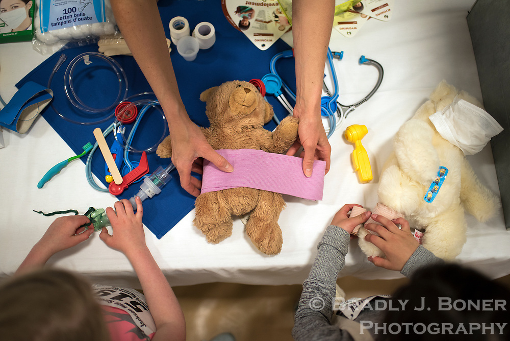 Rose Repinski, 5, left, and Mira Borrego, 7, learn how to properly apply bandages in the Teddy Bear Clinic during the St. John's Community Health Fair on Saturday at the Jackson/Teton County Recreation Center. See this week's Jackson Hole News&Guide for a story on this year's clinic.