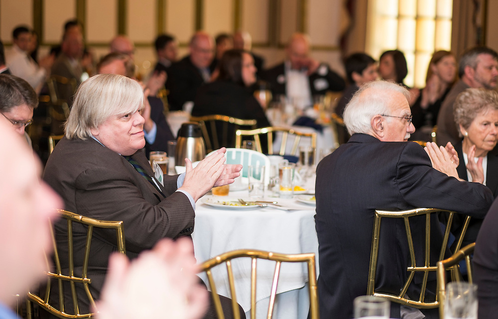 Thomas Suddes, E.W. Scripps School of Journalism Statehouse News Bureau fellowships co-ordinator and assistant professor, and other attendees applaud during the Ohio University State Government Alumni Luncheon on Tuesday, May 5, 2015.  Photo by Ohio University  /  Rob Hardin