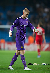 02.10.2013, Etihad Stadion, Manchester, ENG, UEFA Champions League, Manchester City vs FC Bayern Muenchen, Gruppe D, im Bild Manchester City's goalkeeper Joe Hart looks dejected as his side lose 3-1 to Bayern Munich during the UEFA Champions League Group D match between Manchester City vs FC Bayern Munich at the Etihad Stadium, Manchester, Great Britain on 2013/10/02. EXPA Pictures © 2013, PhotoCredit: EXPA/ Propagandaphoto/ David Rawcliffe<br /> <br /> ***** ATTENTION - OUT OF ENG, GBR, UK *****