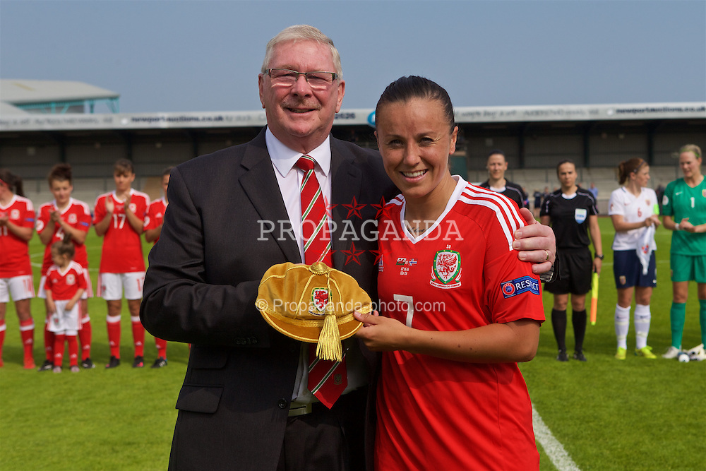 NEWPORT, WALES - Tuesday, June 7, 2016: Wales' Natasha Harding is presented with golden cap by FAW President David Griffiths to mark her 50th appearance for Wales before the UEFA Women's Euro 2017 Qualifying Group 8 match against Norway at Newport Stadium. (Pic by Laura Malkin/Propaganda)