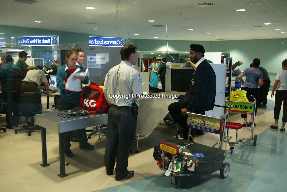 2 December 2002, Indian Cricket Team Arrival, auckland International Airport, New Zealand.<br />Spin bowler Harbhajan Singh is questioned by customs after they detected his shoes containing dirt. He was fined $NZ200<br />Pic: Sandra Teddy/Photosport