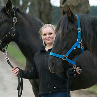 Janine Mason pictured at her farm near Coupar Angus in Perthshire, with 'Spirit' and 'Bia' two of the horses she has rescued from a horse rescue charity in Portugal...19.03.15<br /> Picture by Graeme Hart.<br /> Copyright Perthshire Picture Agency<br /> Tel: 01738 623350  Mobile: 07990 594431