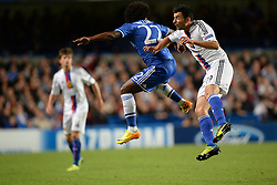 LONDON, ENGLAND - September 18: Chelsea's Willian and Basel's Behrang Safari  during the UEFA Champions League Group E match between Chelsea from England and Basel from Switzerland played at Stamford Bridge, on September 18, 2013 in London, England. (Photo by Mitchell Gunn/ESPA)