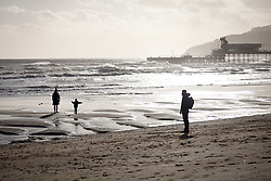 © Licensed to London News Pictures. 30/12/2013. Isle of Wight, UK. People watch the Stormy seas off of the Isle of Wight today 30 December 2013 . Photo credit : Rob Arnold/LNP