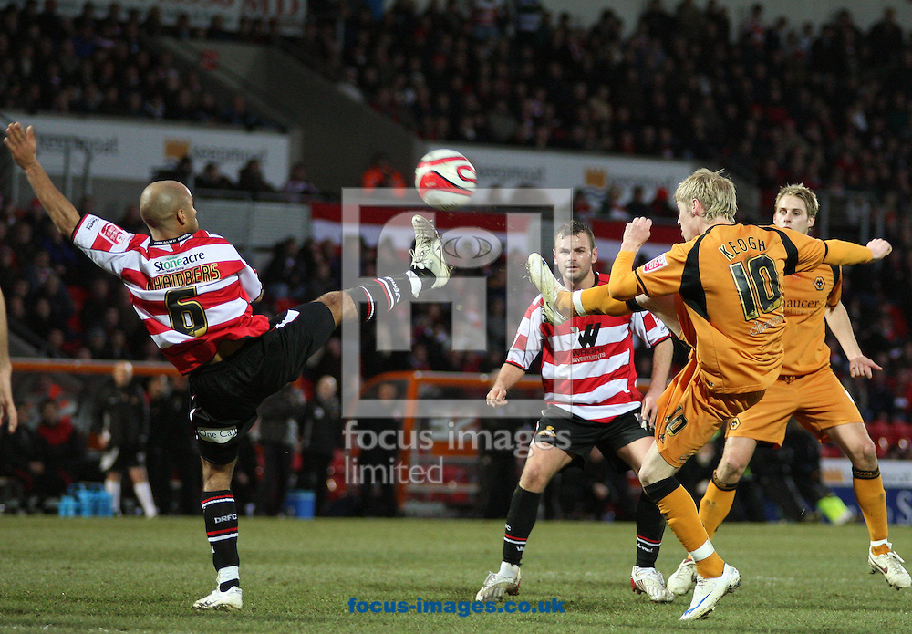 Doncaster - Saturday December 20th 2008: Andrew Keogh of    Wolverhampton Wanderers hits the cross bar with this first half effort despite James Chambers of Doncaster Rovers best effort to block  his shot during the Coca Cola Championship match at The Keepmoat Stadium Doncaster. (Pic by Steven Price/Focus Images)