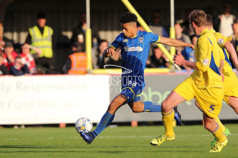Lyle Taylor forward for AFC Wimbledon (33) with an early attempt during  the Sky Bet League 2 Play-Off first leg match between AFC Wimbledon and Accrington Stanley at the Cherry Red Records Stadium, Kingston, England on 14 May 2016. Photo by Stuart Butcher.