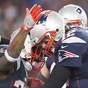 FOXBOROUGH, MASSACHUSETTS - JANUARY 14:  Quarterback Tom Brady #12 of the New England Patriots congratulates team mate running back Dion Lewis #33 of the New England Patriots on a touchdown during the Houston Texans Vs New England Patriots Divisional round game during the NFL play-offs on January 14th, 2017 at Gillette Stadium, Foxborough, Massachusetts. (Photo by Tim Clayton/Corbis via Getty Images)