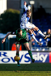 Joe Partington of Bristol Rovers is challenged by Murray Wallace of Scunthorpe United - Rogan/JMP - 24/02/2018 - FOOTBALL - Memorial Stadium - Bristol, England - Bristol Rovers v Scunthorpe United - EFL Sky Bet League One.