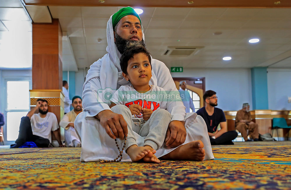 A young boy among worshippers attending Friday prayers at Manchester Central Mosque following the terror attack in the city earlier this week.