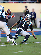 Carolina Panthers quarterback Cam Newton (1) looks at the loose ball as he falls backward after getting strip sacked by Denver Broncos outside linebacker Von Miller (58) causing a fumble that gets recovered in the end zone by Denver Broncos defensive end Malik Jackson (97) for a touchdown good for a 10-0 Broncos lead during the NFL Super Bowl 50 football game against the Denver Broncos on Sunday, Feb. 7, 2016 in Santa Clara, Calif. The Broncos won the game 24-10. (©Paul Anthony Spinelli)