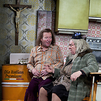 Gregor Fisher as 'Yer Granny' and Paul Riley.<br /> <br /> Yer Granny - a new production by The National Theatre of Scotland opens at the Beacon arts Centre, Greenock, Scotland.<br /> <br /> <br /> Based on La Nona by Roberto Cossa<br /> In a new version by Douglas Maxwell<br /> Directed by Graham McLaren<br /> <br /> <br /> Picture by Drew Farrell<br /> Tel : 07721-735041<br /> Image offered on a speculative basis.<br /> <br /> Yer Granny is a riotous new comedy about a diabolical 100-year-old granny who&rsquo;s literally eating her family out of house and home. She&rsquo;s already eaten their fish and chip shop into bankruptcy and now she&rsquo;s working her way through their kitchen cupboards, pushing the Russo family to desperate measures just to survive beyond 1977.<br /> <br /> As proud head of the family, Cammy is determined that The Minerva Fish Bar will rise again and that family honour will be restored &ndash; and all in time for the Queen&rsquo;s upcoming Jubilee visit. But before Cammy&rsquo;s dream can come true and before Her Maj can pop in for a chat, a single sausage and a royal seal of approval, the family members must ask themselves how far they will go to solve a problem like Yer Granny.<br /> <br /> Adapted from the smash-hit Argentinian comedy classic La Nona, the cast of Yer Granny features some of Scotland&rsquo;s best-loved performers, including Gregor Fisher in the title role, alongside Paul Riley (Still Game), Jonathan Watson (Only An Excuse?), Maureen Beattie (Casualty), Barbara Rafferty (Rab C Nesbitt), Brian Pettifer (The Musketeers) and Louise McCarthy (Mamma Mia!, West End).<br /> <br /> Performance dates :<br /> The Beacon Arts Centre, Greenock<br /> 19/05/2015&nbsp;-&nbsp;21/05/2015 <br /> <br /> King's Theatre, Glasgow<br /> 26/05/2015&nbsp;-&nbsp;30/05/2015 <br /> <br /> King's Theatre, Edinburgh<br /> 02/06/2015&nbsp;-&nbsp;06/06/2015 <br /> <br /> Eden Court, Inverness<br /> <br /> Lyric Theatre, Belfast<br /> 23/06/2015&nbsp;-&n