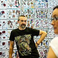 Manchester, UK - 4 August 2012: an artist poses during the Manchester Tattoo Show, one of the most popular conventions of the UK tattoo community.