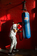 An unaccompanied minor refugee child uses some time at a local boxing club to train, Kent, United Kingdom.  (photo by Andrew Aitchison / In pictures via Getty Images)