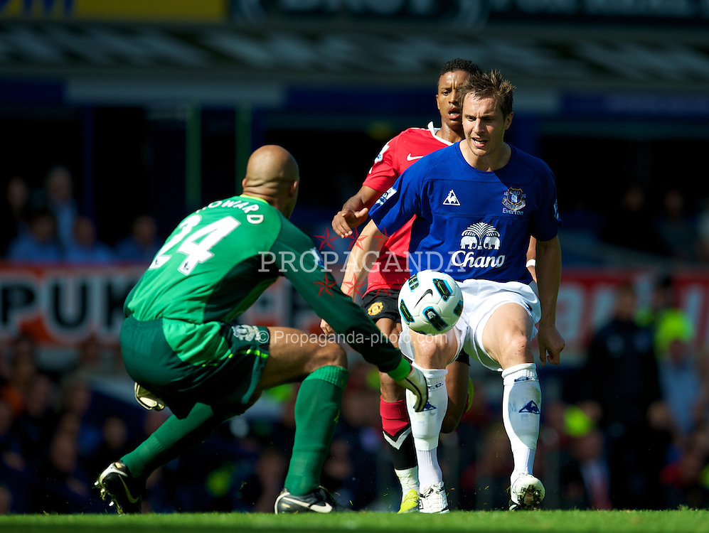 LIVERPOOL, ENGLAND - Saturday, September 11, 2010: Everton's Phil Jagielka and goalkeeper Tim Howard in action against Manchester United during the Premiership match at Goodison Park. (Photo by David Rawcliffe/Propaganda)
