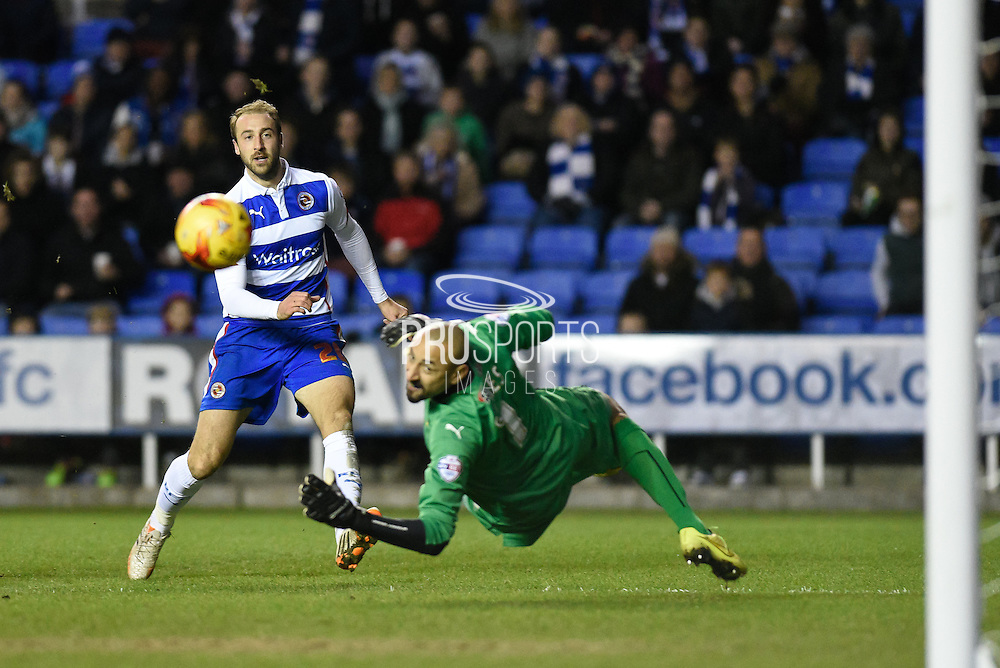 Glenn Murray shoots wide when through on goal during the Sky Bet Championship match between Reading and Watford at the Madejski Stadium, Reading, England on 20 December 2014. Photo by David Charbitt.