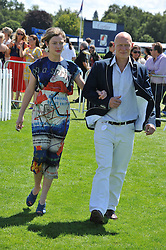 CAMILLA RUTHERFORD and DOMINIC BURNS at the 27th annual Cartier International Polo Day featuring the 100th Coronation Cup between England and Brazil held at Guards Polo Club, Windsor Great Park, Berkshire on 24th July 2011.
