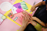 Navleen Hothi, 7, paints her mother's, Gruprit Kahlon, nails during the 1st grade Mother's Day Spa Day at Sinnott Elementary School in Milpitas, California, on May 10, 2013. (Stan Olszewski/SOSKIphoto)