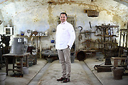 Kent Arnon Masanglong, Chef in charge of the Official Receptions of the Royal Family of Thailand, poses for a portrait in the Cascina Colombara during the annual meeting of the Club des Chefs des Chefs in Livorno Ferraris, Vercelli, Italy, July 18, 2015.<br /> The Club des Chefs des Chefs, which is seen as the world's most exclusive gastronomic society, has extremely strict membership criteria: to be accepted into this highly elite club, you need to be the current personal chef of a head of state. If he or she does not have a personal chef, members can be the executive chef of the venue that hosts official State receptions. One of the society's primary purposes is to promote major culinary traditions and to protect the origins of each national cuisine. The Club des Chefs des Chefs also aims to develop friendship and cooperation between its members, who have similar responsibilities in their respective countries. <br /> The annual meeting of the Club has been hosted this year in the production site of the Italian rice company called Riso Acquerello. <br /> © Giorgio Perottino