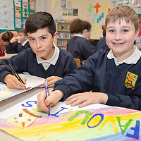 Finn Minogue and Sean O'Connor working on their posters for their Jessies project 'Feakle Family Favourites' Cookbook