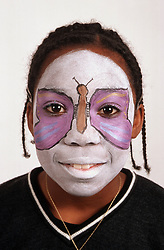 Portrait of girl with painted face,