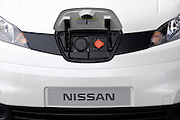 Photo shows the charging point located in the front of a prototype of Nissan's e-NV200 electric vehicle during a test run at the automaker's Oppama test circuit in Yokohama, Japan on 17 Oct. 2012.  Photographer: Robert Gilhooly