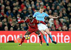 Liverpool's Sadio Mane (left) and Manchester City's Kevin De Bruyne battle for the ball during the Premier League match at Anfield, Liverpool.
