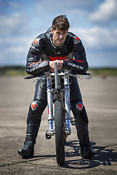 July 1, 2019 - York, Yorkshire, UK - York UK. Neil Campbell, the European cycling speed record holder has been testing his £15,000 custom built Moss bicycle complete with stopping parachute at Elvington airfield in Yorkshire ahead of an attempt to break the 167mph world cycling record later this year. Neil is towed up to speed behind a Porsche Cayenne before he is released & peddles on to his top speed. (Credit Image: © Andrew Mccaren/London News Pictures via ZUMA Wire)